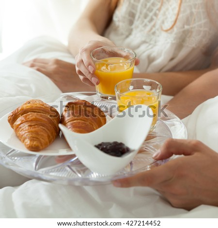 Eating breakfast in bed in lazy morning #427214452