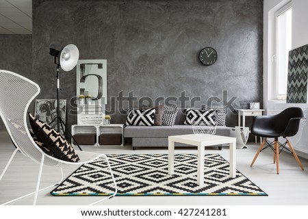 Spacious classic living room in black and white. Interior designed with style Royalty-Free Stock Photo #427241281