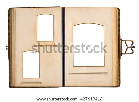 Opened antique photo album with empty frames isolated on white background #427619416