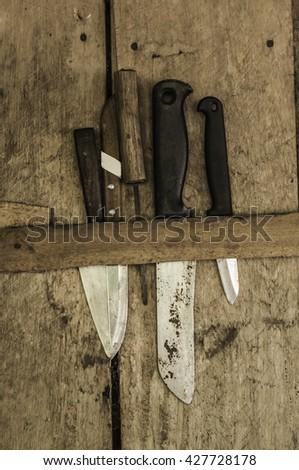 old knife on wood background #427728178