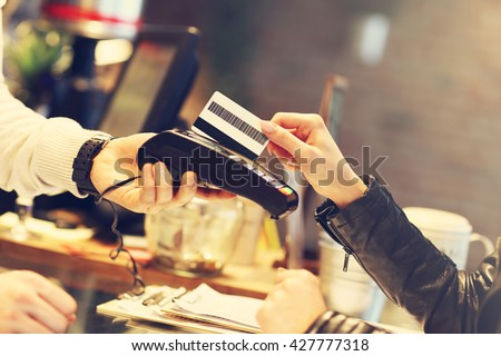 Picture of woman paying by credit card in restaurant
