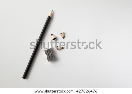 Pencil with sharpening shavings on white background Royalty-Free Stock Photo #427826476