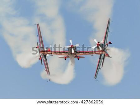 Dangerous Aerobatics Stunt in the Airshow #427862056