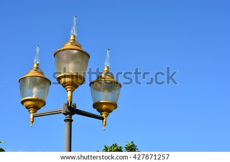Beautiful Lamp in garden over Blue sky Back ground #427871257