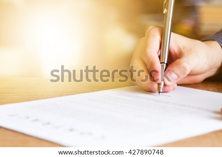 business man signing contract document on office desk #427890748