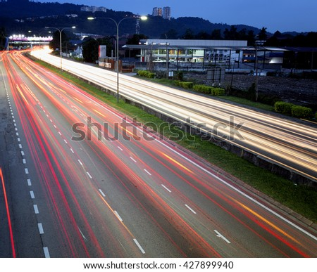 Highway full of cars during night time. #427899940