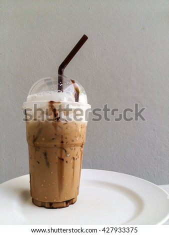 Fresh coffee in a cup with a brown plastic straw #427933375