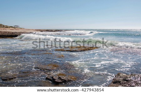 Glistening Indian Ocean seascape with waves and natural rock formations at Jake's Point in Kalbarri, Western Australia/Left Point Break: Jake's Point/Kalbarri, Western Australia #427943854