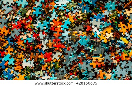 Pieces of a puzzle Royalty-Free Stock Photo #428150695