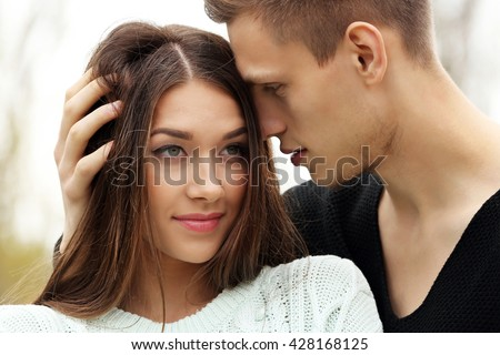 Young man touching hair of young woman #428168125
