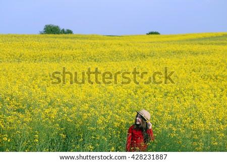 beautiful little girl with straw hat on field summer season #428231887