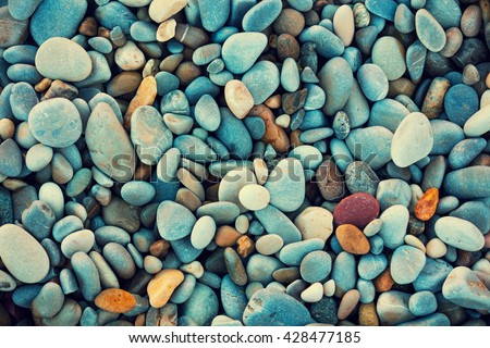 Abstract nature pebbles background. Blue pebbles texture. Stone background.  Blue vintage color. Sea peblles beach. Beautiful nature. Turquoise color Royalty-Free Stock Photo #428477185