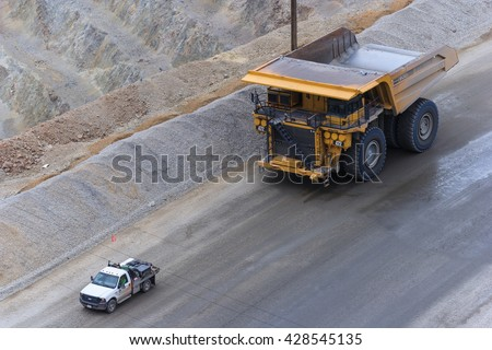 Salt Lake City, UT/USA - circa August 2011: Huge ore trucks at Bingham Canyon Mine, also know as Kennecott Copper Mine in Salt Lake City, Utah #428545135
