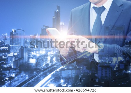 Double exposure of professional businessman using cloud technology in smart phone with servers technology in data center and network connection in IT Business technology concept #428594926