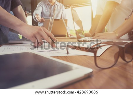 Business man hand pointing at business document during discussion at meeting.vintage tone Royalty-Free Stock Photo #428690086