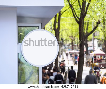 Signboard shop Mock up Signage Round shape display Shopping street with people walking