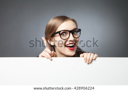 woman with finger up looking at camera #428906224
