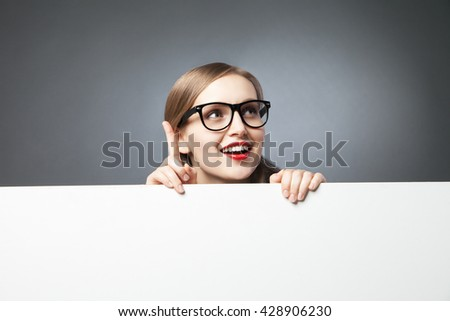woman with finger up looking at camera #428906230