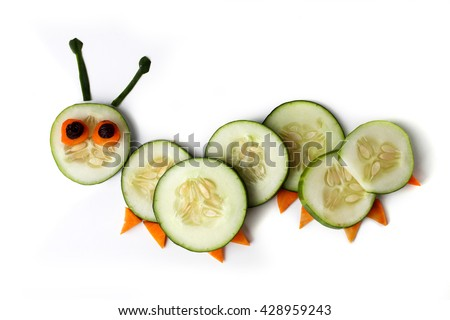 Food art creative concepts. Cute caterpillar made of cucumber and carrots isolated on a white background.