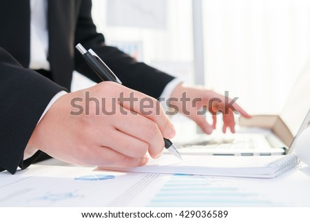 Business people using a pencil noting over laptop #429036589