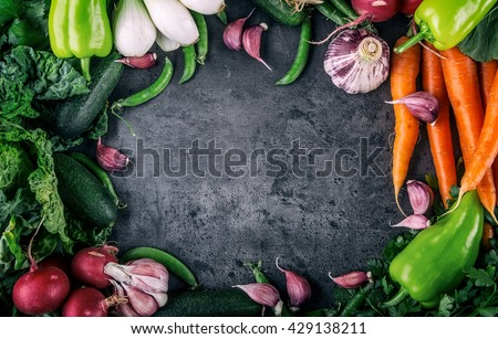 Assortment of fresh vegetables. Carrot garlic peas cabbage onion celery cucumber parsnip and radish concrete board. #429138211