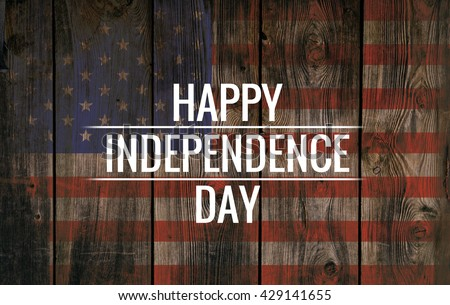 Inscription Happy independence day on usa flag. Grunge background. Wooden texture. Royalty-Free Stock Photo #429141655