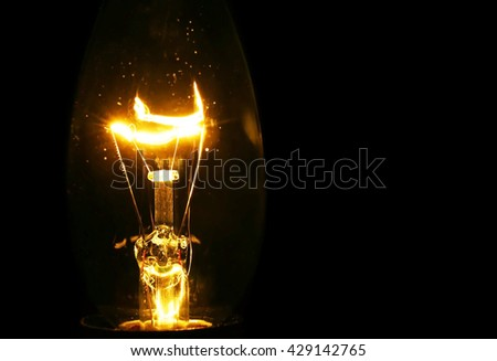 Illuminated light bulb on black background #429142765