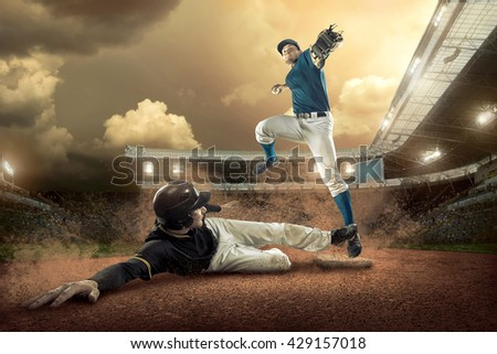 Baseball players in action on the stadium. #429157018