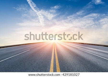 New asphalt highway at sunset scene #429181027