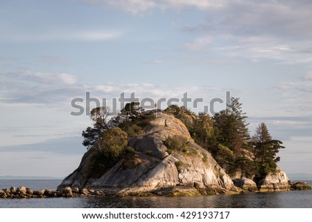 Perspective view of a man isolation at the top of a small island. #429193717
