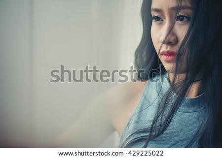 Portrait of pensive unsmiling Vietnamese woman #429225022