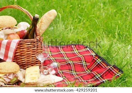 Picnic basket with apples bread cheese wine and sandwiches #429259201
