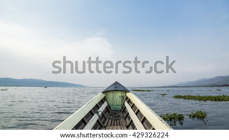 View from a fishing boat on an adventure trip getting to Inle Lake on a clear blue sky  day  #429326224