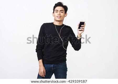 handsome asian using his smartphone to hear music #429339187