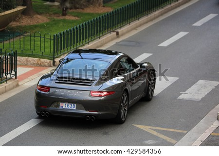Monte-Carlo, Monaco - May 18, 2016: Luxury Black Porsche 911 Carrera S on Avenue Princesse Grace in Monte-Carlo, Monaco in the south of France