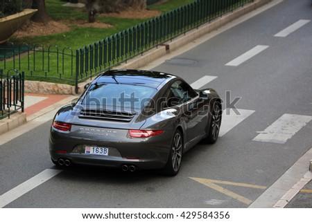 Monte-Carlo, Monaco - May 18, 2016: Luxury Black Porsche 911 Carrera S on Avenue Princesse Grace in Monte-Carlo, Monaco in the south of France #429584356