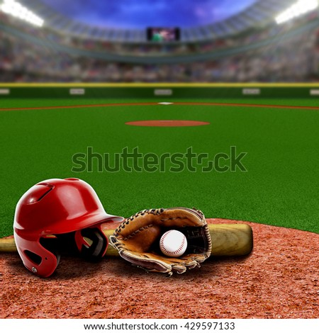 Baseball stadium full of fans in the stands with baseball helmet, bat, glove and ball on infield dirt clay. Deliberate focus on equipment and foreground with shallow depth of field on background. Royalty-Free Stock Photo #429597133