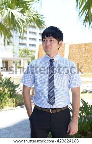 Smiling Asian businessman #429624163