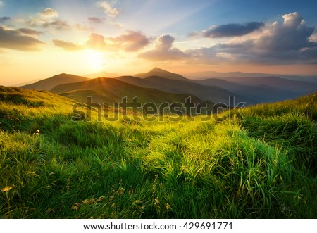 Mountain valley during sunrise. Natural summer landscape #429691771