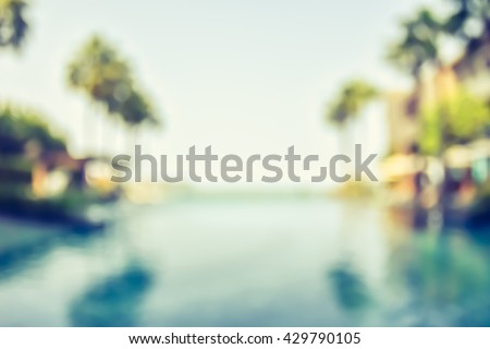 Blur summer background for resort hotel pool party with blue cool sky and tropical palm tree