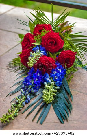 Funeral bouquet made of red roses #429893482