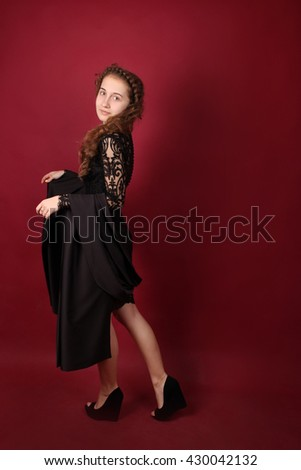 Pretty girl in fashionable stylish clothes. Attractive model dressed in black guipure dress. Young woman in a beautiful evening dress. Beautiful Brunette with Hairstyle. Beauty, fashion, style. #430042132
