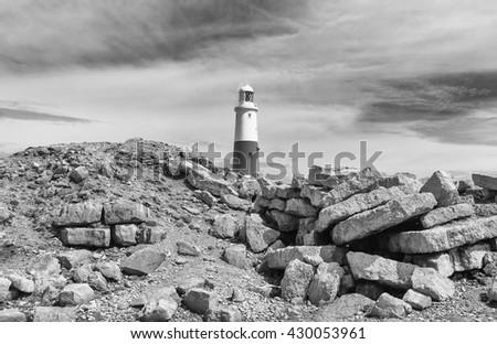 The lighthouse at Portland Bill on Dorset's Jurassic Coast in monochrome.  #430053961