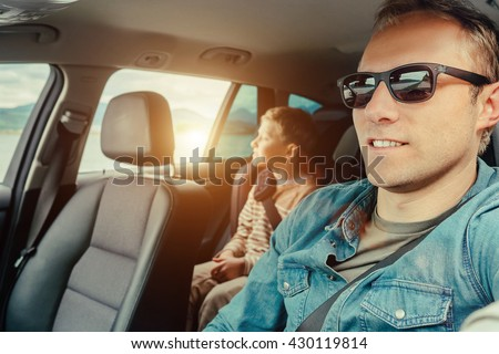 Father with son sit in car #430119814