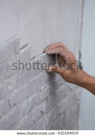 worker install stone wall tile with cement for house decoration #430184059