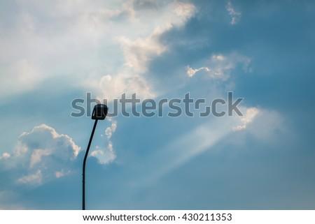 a light poles and the sun #430211353