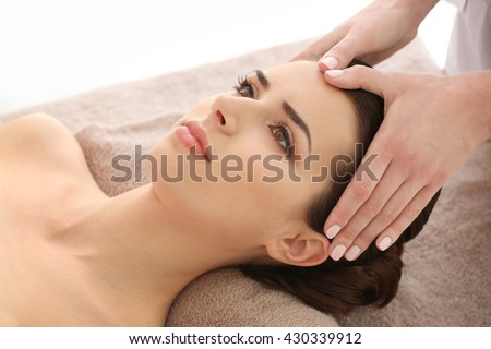 Young woman having massage in spa salon #430339912