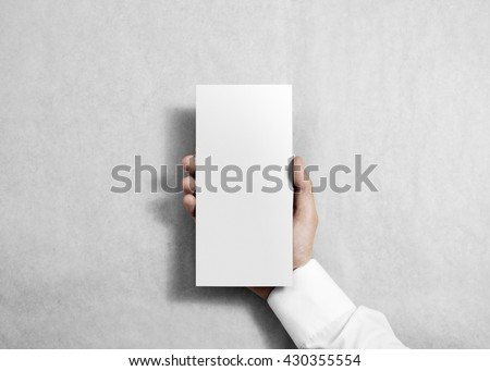 Hand holding blank white flyer brochure booklet. Leaflet presentation. Pamphlet hold hands. Man show clear offset paper. Sheet template. Booklet design sheet display read first person #430355554
