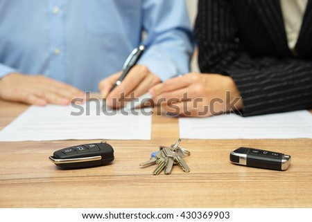 woman is showing partner where to sign on divorce decree #430369903