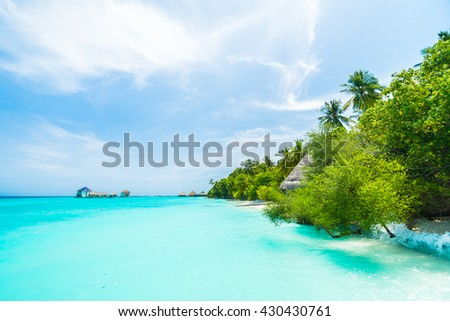 Beautiful tropical Maldives resort hotel and island with beach and sea on sky for holiday vacation background concept - Boost up color Processing #430430761